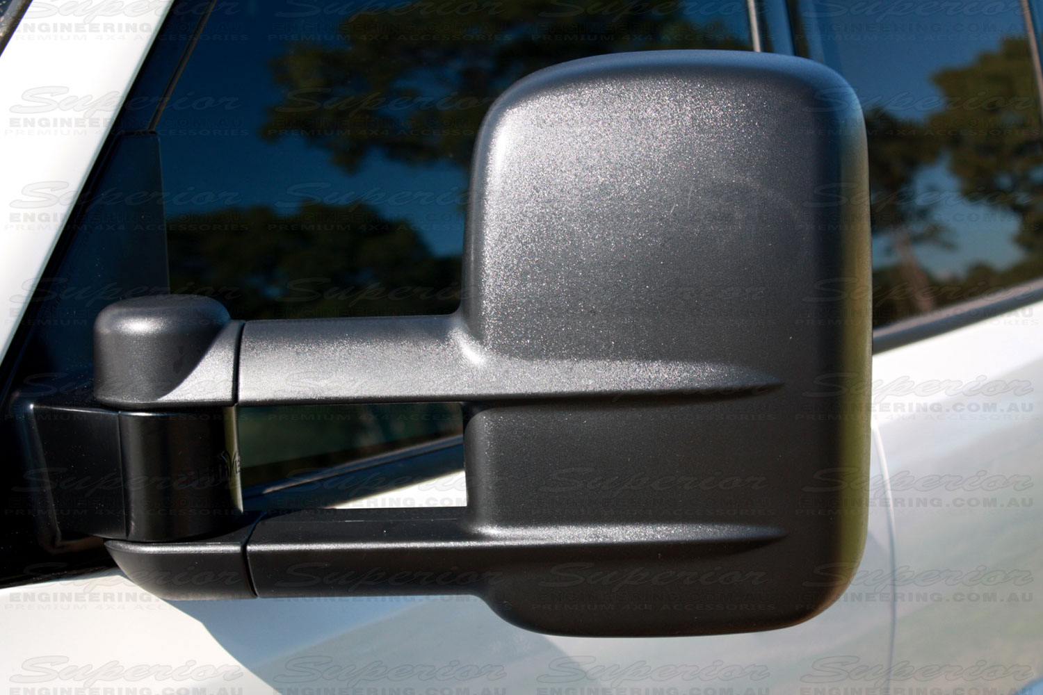 Closeup view of black Clearview Towing Mirror fitted to a late model Pajero