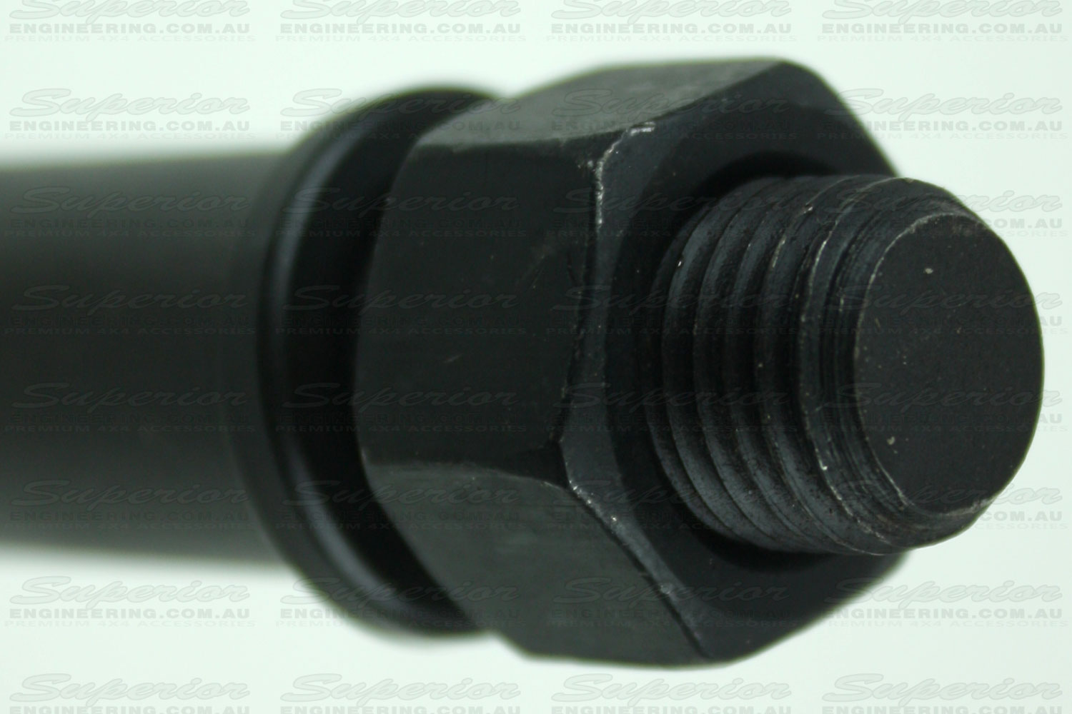 Closeup view of the main nut and washer on the fixed pin