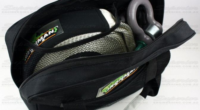 Opening the tough Ironman recovery bag to show the snatch strap, hitch and shackle included in the kit