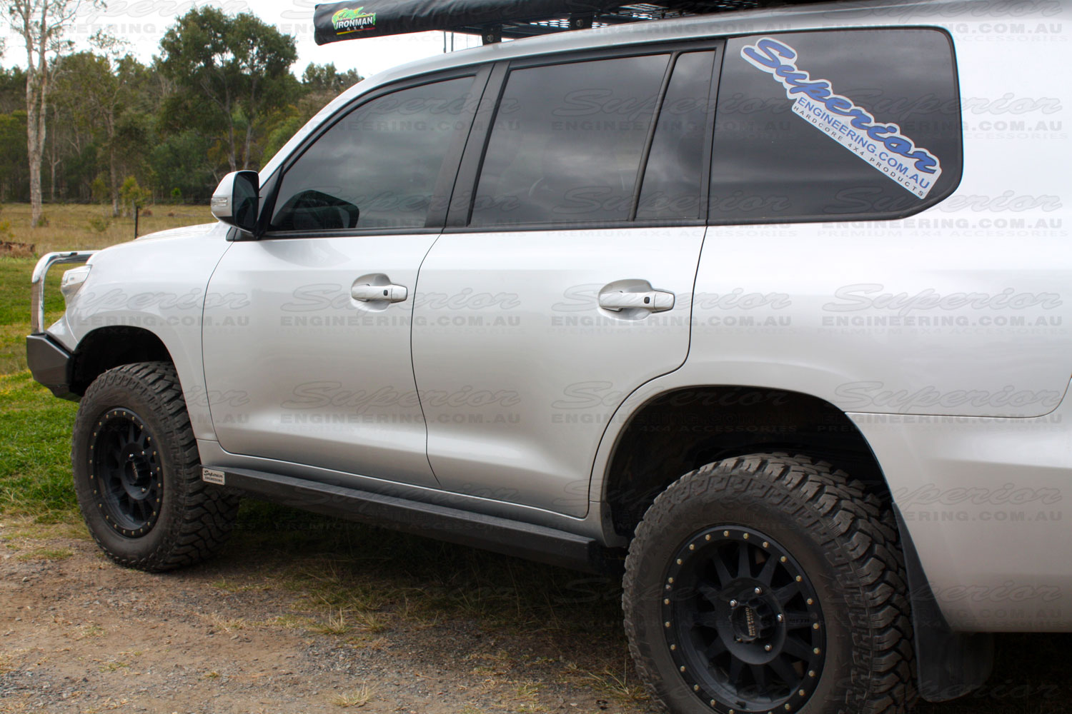 Rear left side view of a Superior Engineering Stealth Rock Slider fitted to a Toyota Landcruiser 200 Series