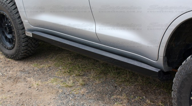 Close up view of a Superior Engineering Stealth Rock Slider fitted to a Toyota Landcruiser 200 Series - Rear closest to camera