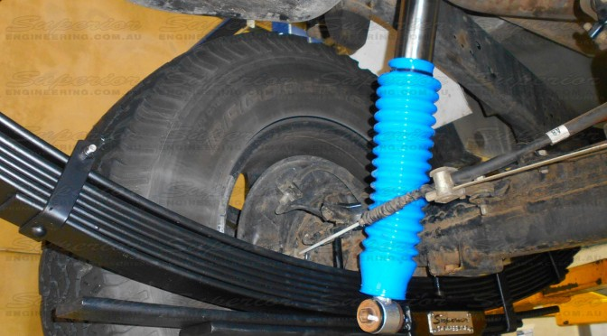 Full rear suspension fitout with remote reservoir monotube shock absorbers, heavy duty leaf springs and u-bolt plates