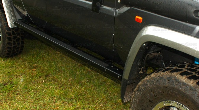 Close up view of some new Superior Stealth Rock Sliders on a Toyota Landcruiser 79 Series