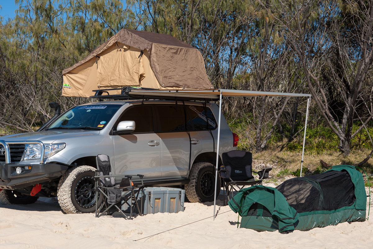 Complete c&site featuring the Ironman Roof Top Tent & ironman-4x4-rooftop-tent-campsite | 4x4 Accessories Online