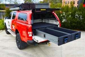 Rear side view of the dual drawers fully extended displaying the pro-glide system and safe and secure locking system