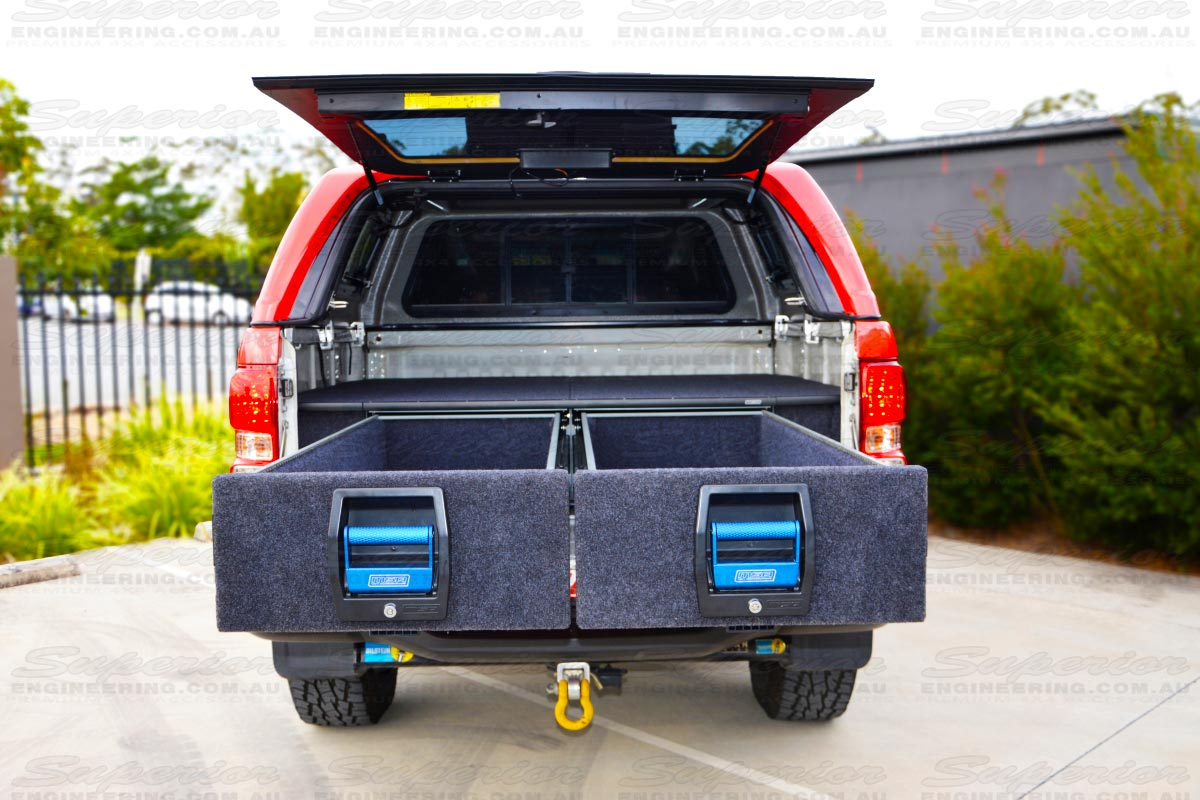 Rear view of the Holden Colorado with the MSA 4x4 Drawer System fitted with both drawers open showing the storage area, handles and carpet area