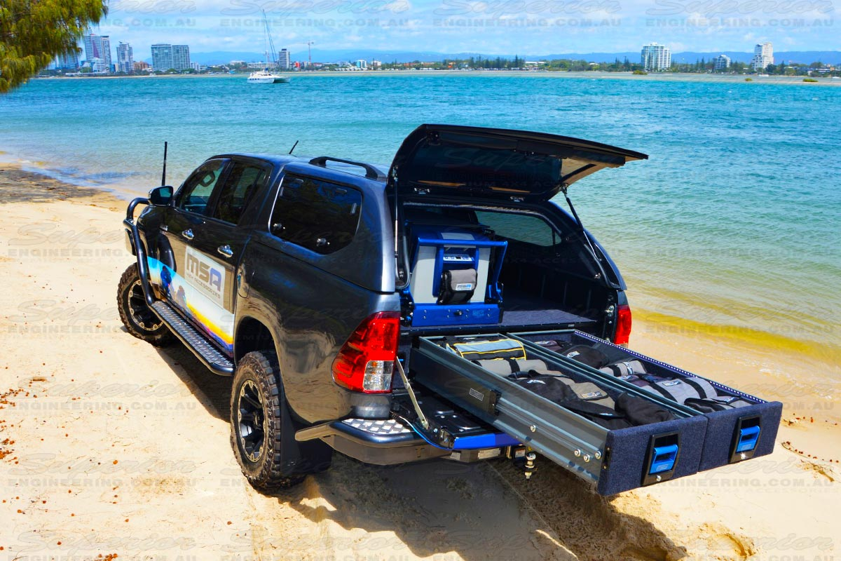 Rear side view a Current Model Toyota Hilux with the MSA 4x4 draw system complete with both drawers open to show how much room is available