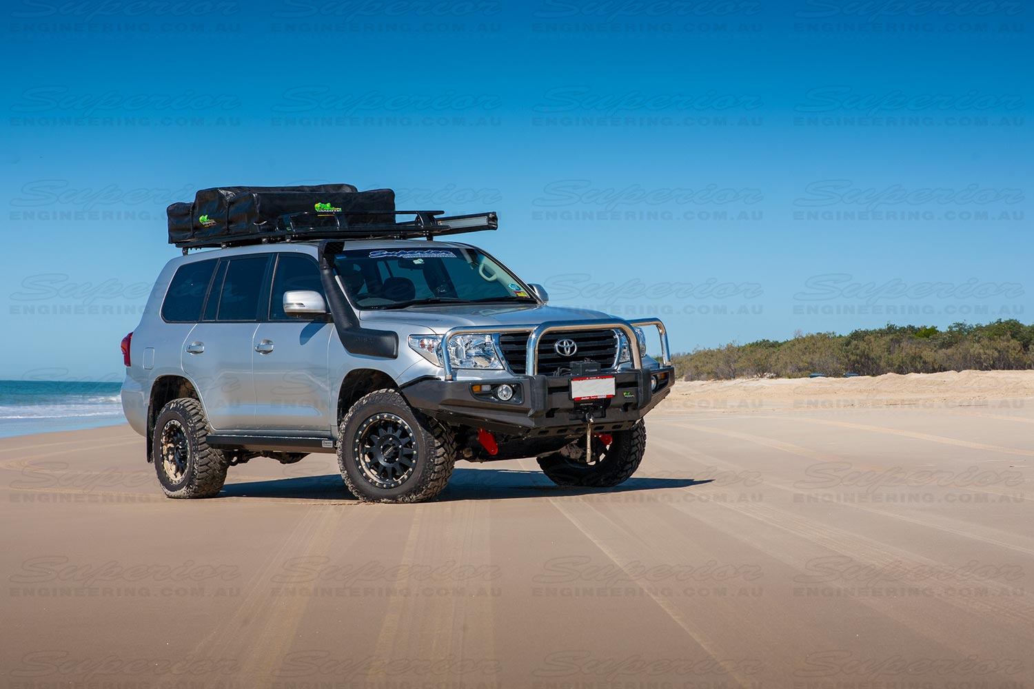 Right side view of a 200 Series Landcruiser on Bribie Island beach with the recovery point installed