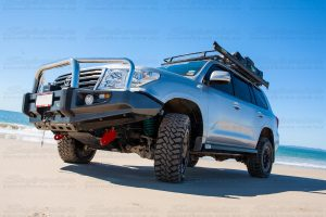 Left side view of a 200 Series Toyota Landcruiser on the beach at Bribie Island fitted with a set of recovery points