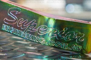 Closeup view of the Superior Engineering logo engraved onto the face of the Coil Retainer